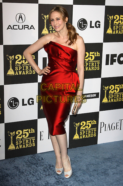 VERGA FARMIGA .25th Annual Film Independent Spirit Awards held At The Nokia LA Live, Los Angeles, California, USA,.March 5th, 2010 ..arrivals Indie Spirit full length red strapless dress silk satin hand on hip peep toe shoes white cream clutch bag .CAP/ADM/KB.©Kevan Brooks/Admedia/Capital Pictures