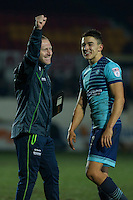 Assistant manager Richard Dobson and Luke O'Nien of Wycombe celebrate their side's win at full time of the Sky Bet League 2 match between Newport County and Wycombe Wanderers at Rodney Parade, Newport, Wales on 22 November 2016. Photo by Mark  Hawkins.