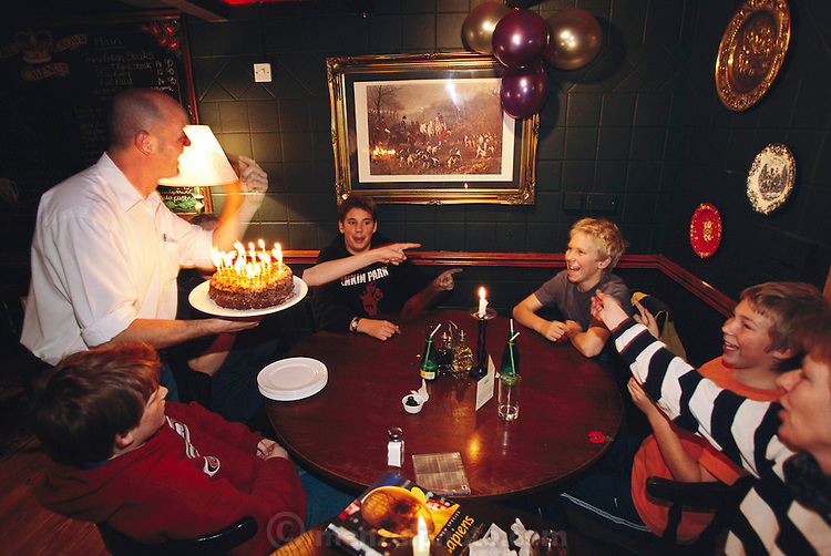 Friends and family celebrate Josh Bainton's 14th birthday party on Saturday night at The Crown, the neighborhood pub. Hungry Planet: What the World Eats (p. 143). /// The Bainton family of Collingbourne Ducis, Wiltshire, England, is one of the thirty families featured, with a weeks' worth of food, in the book Hungry Planet: What the World Eats.