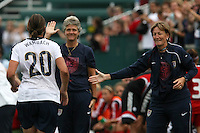 USWNT's Abby Wambach (20) runs toward her coach, Pia Sundhage (ctr) and assistant coach Janet Rayfield after scoring her 100th career goal in the second half. The U.S. Women's National Team defeated Canada 1-0 in a friendly match at Marina Auto Stadium in Rochester, NY on July 19, 2009.