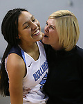 Centennial's Jade Thomas celebrates with an assistant coach after her shot at the buzzer forced the title game against Liberty into overtime at the NIAA state basketball tournament in Reno, Nev., on Friday, Feb. 23, 2018. Centennial won 74-65 in OT. Cathleen Allison/Las Vegas Review-Journal