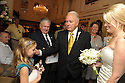 Former Governor Edwin Edwards introduces his new bride, Trina Grimes Scott, to a young hotel guest after a ceremony in the French Quarter in New Orleans, La., Friday, July 29, 2011. Edwards was recently released from prison where he served eight years on corruption charges....(AP Photo/Cheryl Gerber)
