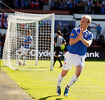 Steven Naismith celebrates his first goal of the match