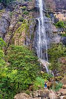 Tourist visiting Bambarakanda Falls, a waterfall near Haputale, Sri Lanka Hill Country, Nuwara Eliya District, Asia. This is a photo of a tourist visiting Bambarakanda Falls, a waterfall near Haputale, Sri Lanka Hill Country, Nuwara Eliya District, Asia.