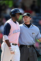 Designated hitter Kendrick Perkins (10) of the Greenville Drive argues with home plate umpire Tyler Ferguson in a game against the West Virginia Power on Sunday, May 11, 2014, at Fluor Field at the West End in Greenville, South Carolina. Greenville won, 9-6. (Tom Priddy/Four Seam Images)