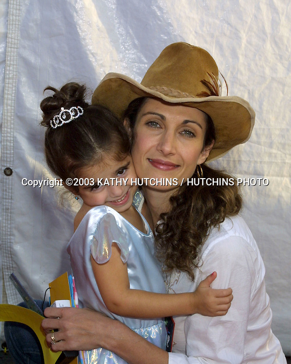 ©2003 KATHY HUTCHINS / HUTCHINS PHOTO.DREAM HALLOWEEN BENEFIT.SANTA MONICA, CA.OCTOBER 25, 2003..MELINA KANAKAREDES.AND DAUGHTER ZOE 3 YRS OLD