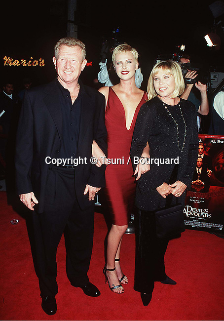 Theron Charlize and dad + mom