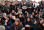 CHAMCHAMAL, IRAQ: Women weep during the funeral ceremony of 104 Kurds discovered in a mass grave...On April 15, 2010, Iraqi Kurds held a ceremony to honor the 102 children and 2 pregnant women discovered in a mass grave near the town of Dibis.  They are believed to have been killed in the 1988 Anfal genocidal campaign against Iraq's Kurds.