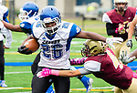 WATERBURY,  CT-101219JS20- Crosby's Edric Guzman (26) gets tackled by Sacred Heart-Kaynor's Tommy Romero (4) during their game Saturday at Municipal Stadium in Waterbury.<br /> Jim Shannon Republican-American