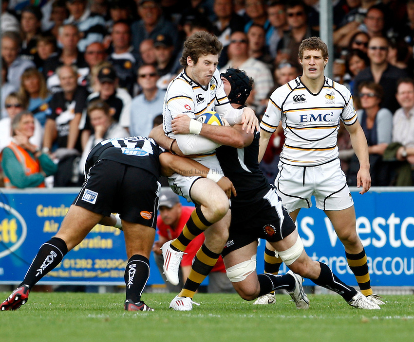 Photo: Richard Lane/Richard Lane Photography. Exeter Chiefs v London Wasps. Aviva Premiership. 25/09/2011. Wasps' Elliot Daly is tackled.