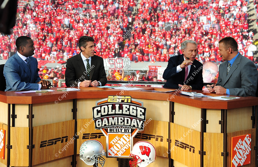 Desmond Howard, Chris Fowler, Lee Corso and Kirk Herbstreit (left to right) broadcast during ESPN Gameday at Camp Randall Stadium before the Wisconsin / Ohio State football game on Saturday, 10/16/10 in Madison, Wisconsin