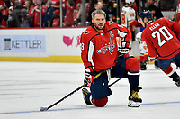 WASHINGTON, DC - NOVEMBER 03: Capitals left wing Alexander Alex Ovechkin (8) watches during warm ups before the Calgary Flames vs. Washington Capitals on November 3, 2019 at Capital One Arena in Washington, D.C.. (Photo by Randy Litzinger/Icon Sportswire)