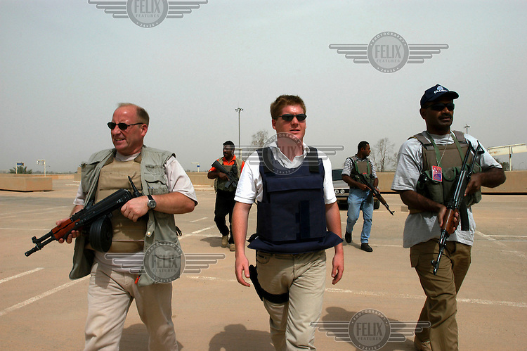 Security contractors from Global Risk Strategies on an escort mission at Baghdad International airport. The security and risk management firm has more than 1,000 personnel in Iraq.