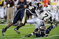 22 November 2008:  FIU defensive lineman Jarvis Penerton (96) tackles Louisiana-Monroe quarterback Kinsmon Lancaster (7) in the ULM 31-27 victory over FIU at FIU Stadium in Miami, Florida.