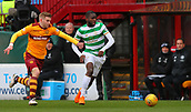 18th March 2018, Fir Park, Motherwell, Scotland; Scottish Premiership football, Motherwell versus Celtic;  Chris Cadden tussles with Odsonne Edouard as he breaks forward with the ball