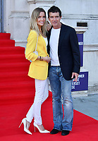 """LONDON, UK, AUGUST 08: Nicole Kimpel and Antonio Banderas attend the opening night of Film4 Summer Screen at Somerset House featuring the UK Premiere of """"Pain And Glory"""" on August 8, 2019 in London, England. <br /> CAP/JOR<br /> ©JOR/Capital Pictures"""