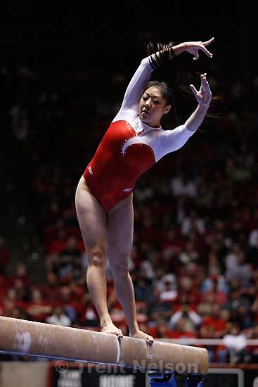 Utah's Nina Kim tries to maintain her balance on the beam. Kim scored a 9.375. , Utah vs. Florida, women's college gymnastics Friday night at the Huntsman Center.