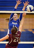 NWA Democrat-Gazette/BEN GOFF @NWABENGOFF<br /> Hannah Martin of Rogers jumps to block as Madison Cooper of Siloam Springs hits the ball over on Thursday Aug. 27, 2015 during the match at Rogers High.