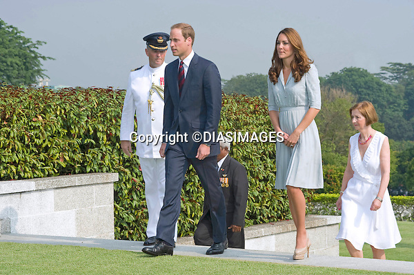 "CATHERINE, DUCHESS OF CAMBRIDGE AND PRINCE WILLIAM.visited the Kranji War Cemetery on their last day of their vsit to Singapore_13/09/2012.The Duchess used a parasol to protect her from the sun while she viewed the war graves..Mandatory credit photo: ©Dias/DIASIMAGES..(Failure to credit will incur a surcharge of 100% of reproduction fees)..                **ALL FEES PAYABLE TO: ""NEWSPIX INTERNATIONAL""**..IMMEDIATE CONFIRMATION OF USAGE REQUIRED:.DiasImages, 31a Chinnery Hill, Bishop's Stortford, ENGLAND CM23 3PS.Tel:+441279 324672  ; Fax: +441279656877.Mobile:  07775681153.e-mail: info@newspixinternational.co.uk"