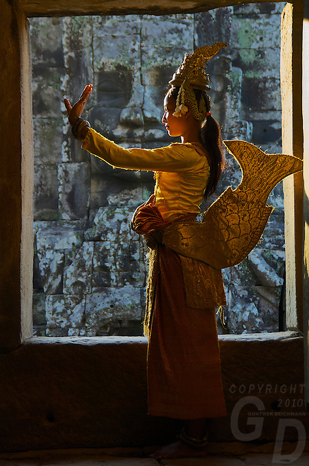 Khmer dancer in the ancient temple ruins at Bayon, Cambodia
