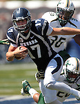 Nevada quarterback Cody Fajardo (17) runs from South Florida defenders Sam Barrington (36) and Mark Joyce (26) during the first half of an NCAA college football game Saturday, Sept. 8, 2012, in Reno, Nev. (AP Photo/Cathleen Allison)