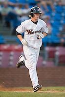Winston-Salem left fielder Aaron Cunningham (34) runs down the first base line versus Wilmington at Ernie Shore Field in Winston-Salem, NC, Saturday, June 9, 2007.