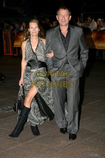 JACQUI HAMILTON-SMITH & SEAN PERTWEE.At The Goal Film Premiere held at the Odeon Cinema,.Leicestre Square,.London, 15th September 2005.full length grey gray suit black pattern print dress slit boots .Ref: AH.www.capitalpictures.com.sales@capitalpictures.com.© Capital Pictures.