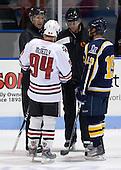 Tyler McNeely (NU - 94), Marc Menzione (Bentley - 19) - The Northeastern University Huskies defeated the Bentley University Falcons 3-2 on Friday, October 16, 2009, at Matthews Arena in Boston, Massachusetts..