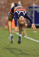 A Virginia Cavaliers cheerleader does flips during the game at Scott Stadium. Virginia was defeated 30-24. (Photo/Andrew Shurtleff)