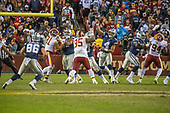 Dallas Cowboys quarterback Dak Prescott (4) releases a pass in late fourth quarter action against the Washington Redskins at FedEx Field in Landover, Maryland on Sunday, October 21, 2018.  Identifiable from left: Dallas Cowboys tight end Dalton Schultz (86), Washington Redskins linebacker Ryan Kerrigan (91), Washington Redskins defensive tackle Da'Ron Payne (95), and Washington Redskins linebacker Preston Smith (94).  The Redskins won the game 20 - 17.<br /> Credit: Ron Sachs / CNP