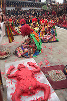 Human effigy is cut up to remove negativity at the Monlam Chenpo, Katok Dorjeden Monastery - Kham, (Tibet), Sichuan, China
