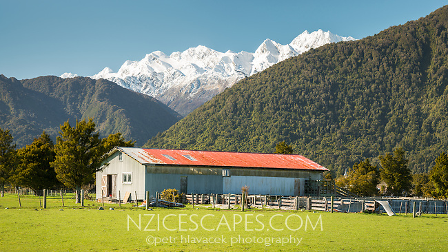 Farming shed in Whataroa with Southern Alps in background, West Coast, South Westland, New Zealand
