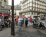 VMI Vincentian Heritage Tour: Members of the Vincentian Mission Institute cohort walk along the outside of Vincent de Paul's apartment on the Rue du Faubourg Saint-Denis, Thursday, June 23, 2016, as they toured Vincentian sites in Paris. (DePaul University/Jamie Moncrief)