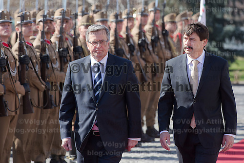Bronislaw Komorowski (L) president of Poland and his Hungarian counterpart Janos Ader (R) inspect the guard of honor during a welcoming ceremony in Budapest, Hungary on March 21, 2014. ATTILA VOLGYI