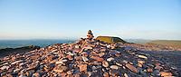 Rock Cairn on summit of Corn Du with Pen Y Fan in background, Brecon Beacons, Wales