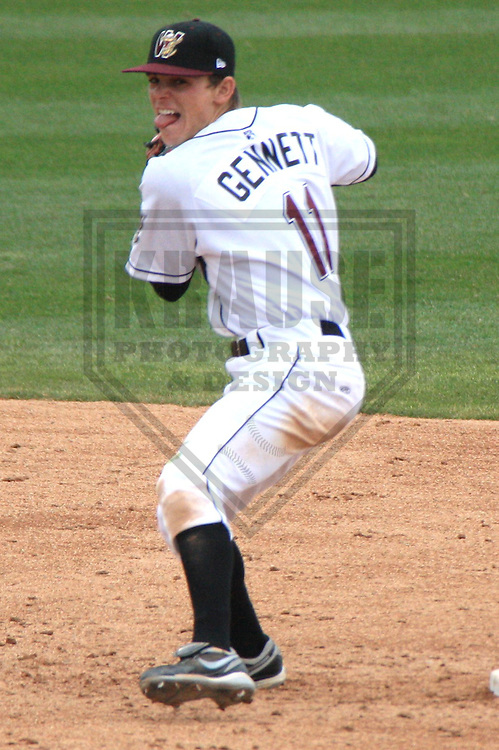 APPLETON - APRIL 2010: Scooter Gennett #11 of the Wisconsin Timber Rattlers, Class-A affiliate of the Milwaukee Brewers, turns a double play during a game on April 12, 2010 at Fox Cities Stadium in Appleton, Wisconsin. (Photo by Brad Krause)