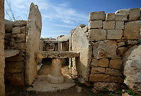 Detail of a stone table and walls in the Mnajdra Temple complex, c.3600-3200 BC, Malta, pictured on June 5, 2008, in the morning. The Republic of Malta consists of seven islands in the Mediterranean Sea of which Malta, Gozo and Comino have been inhabited since c.5,200 BC. It has been ruled by Phoenicians (Malat is Punic for safe haven), Greeks, Romans, Fatimids, Sicilians, Knights of St John, French and the British, from whom it became independent in 1964. Nine of Malta's important historical monuments are UNESCO World Heritage Sites, including  the well preserved Mnajdra Temple complex. Spectacularly sited on the Southern coast of Malta the three temples radiate from an oval forecourt. The lower temple is astronomically aligned so that the sun's rays shine straight through the doorway on the equinoxes. Picture by Manuel Cohen.