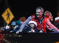 """NWA Democrat-Gazette/CHARLIE KAIJO Springdale Mayor Doug Sprouse greets attendees, Saturday, November 30, 2019 during an annual Christmas parade along Emma Ave. in Springdale.<br /> <br /> Floats, bands and Santa greeted visitors for the 23rd annual Christmas parade. This year's theme was """"Christmas Vacation"""". The parade started at Parsons Stadium and headed west on Emma Avenue, concluding at Harris Street."""
