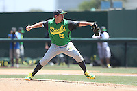 Trent Paddon #25 of the Oregon Ducks pitches against the UCLA Bruins at Jackie Robinson Stadium on May 18, 2014 in Los Angeles, California. Oregon defeated UCLA, 5-4. (Larry Goren/Four Seam Images)