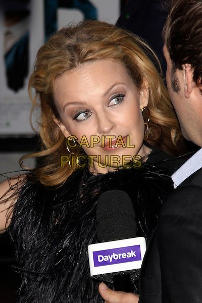 KYLIE MINOGUE.'The Kid' UK premiere held at the Odeon West End, Leicester Square, London, England..September 15th, 2010.headshot portrait marabou fluffy fur furry collar sleeveless gold hoop earrings daybreak microphone interview .CAP/AH.©Adam Houghton/Capital Pictures...