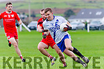 St Mary's Denis Daly shows determination as he pulls clear of Waterville's Fergal Cronin.