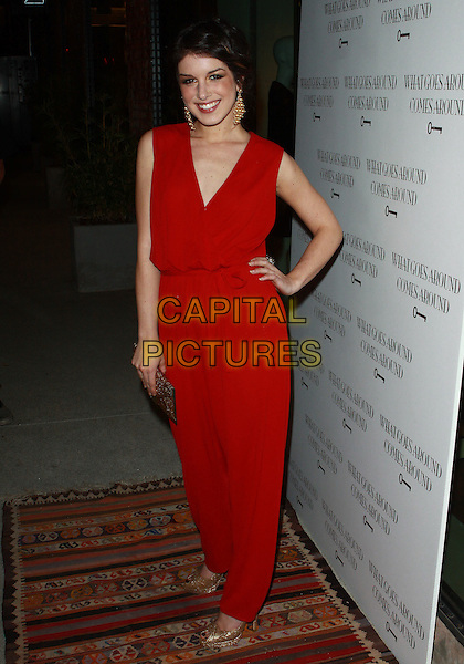 SHENAE GRIMES .WGACA 1 Year Anniversary Party  held at Space15Twenty, Los Angeles, California, USA, 18th March 2010..one arrivals full length red sleeveless catsuit jumpsuit hand on hip gold peep toe shoes clutch bag .CAP/ADM/TC.©T. Conrad/AdMedia/Capital Pictures.