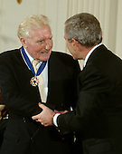 """Washington, D.C. - December 15, 2006 -- Paul Johnson receives the Presidential Medal of Freedom  from United States President George W. Bush and first lady Laura Bush during a ceremony in the East Room of the White House on Friday, December 15, 2006.  The medal is the nation's highest civil award.  It may be awarded """"to any person who has made an especially meritorious contribution to (1) the security or national interests of the United States, or, (2) world peace, or (3) cultural or other significant public or private endeavors"""".  A brilliant historian and journalist, Paul Johnson's powerful writings have captivated and educated people around the world.  From histories of Judaism and Christianity, to the defining events, ideas, and personalities of the 20th Century, to the story of the American people, he has eloquently chronicled the forces that have shaped our world.  A citizen of the United Kingdom, he holds America in special regard, calling the creation of our Nation """"the greatest of all human adventures.""""  The United States honors Paul Johnson for his landmark contributions to sharing the lessons of the past so that they may inform the present and shape the future.<br /> Credit: Ron Sachs / CNP"""