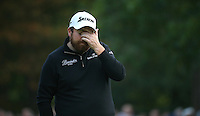 The pain is clear. Shane Lowry (IRL) finishes T2 during the Final Round of the British Masters 2015 supported by SkySports played on the Marquess Course at Woburn Golf Club, Little Brickhill, Milton Keynes, England.  11/10/2015. Picture: Golffile | David Lloyd<br /> <br /> All photos usage must carry mandatory copyright credit (© Golffile | David Lloyd)