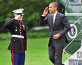 United States President Barack Obama salutes the Marine Guard after landing on the South Lawn of the White House in Washington, D.C. on Wednesday, October 26, 2011.   The President returned from a three day campaign trip to California, Nevada, and Colorado..Credit: Ron Sachs / Pool via CNP