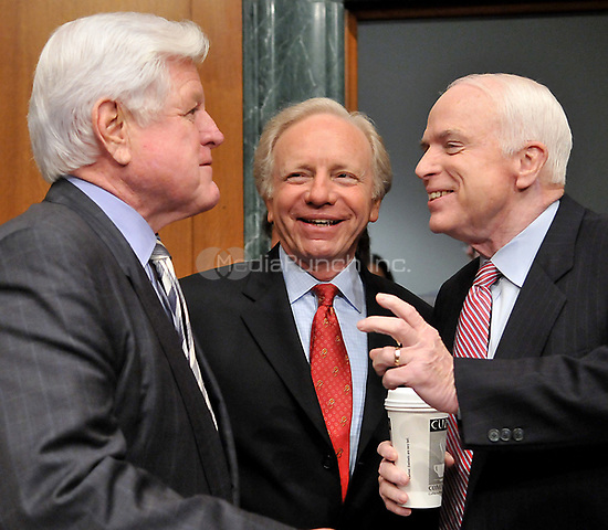 "Washington, DC - April 8, 2008 -- From left to right: United States Senators Edward M. ""Ted"" Kennedy, (Democrat of Massachusetts); Joseph I. Lieberman (Independent Democrat of Connecticut), and John McCain (Republican of Arizona) share a conversation prior to hearing the testimony of General David Petraeus and Ambassador Ryan Crocker before the United States Senate Armed Services Committee on the situation and progress in Iraq in Washington, D.C. on Tuesday, April 8, 2008..Credit: Ron Sachs / CNP/MediaPunch"