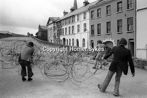 Derry Northern Ireland Londonderry. 1979. Barbed wire is removed from the top of the old city wall.