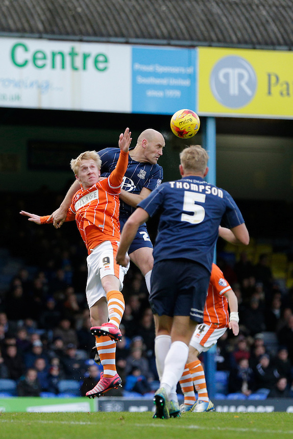 Southend United's John White wins a header under pressure from Blackpool's Mark Cullen<br /> <br /> Photographer Craig Mercer/CameraSport<br /> <br /> Football - The Football League Sky Bet League One - Southend United v Blackpool - Saturday 21st November 2015 - Roots Hall - Southend<br /> <br /> &copy; CameraSport - 43 Linden Ave. Countesthorpe. Leicester. England. LE8 5PG - Tel: +44 (0) 116 277 4147 - admin@camerasport.com - www.camerasport.com