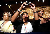 A supporter of United States President Barack Obama takes a picture of him as he speaks at a Democratic National Committee (DNC) fundraiser in Washington, DC, on Monday, May 16, 2011. .Credit: Joshua Roberts / Pool via CNP