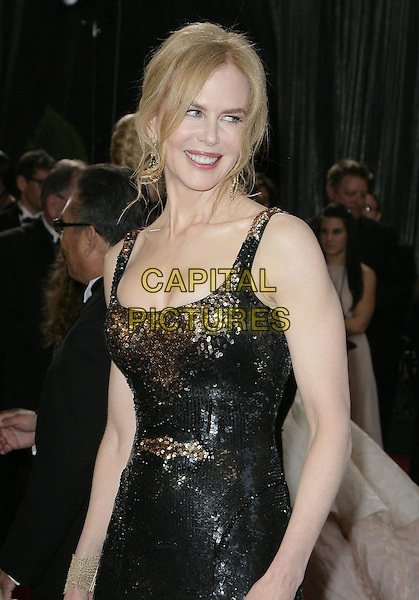 Nicole Kidman (wearing Balenciaga)  .85th Annual Academy Awards held at the Dolby Theatre at Hollywood & Highland Center, Hollywood, California, USA..February 24th, 2013.oscars oscars half length black dress gold sequins sequined sleeveless  .CAP/ADM.©AdMedia/Capital Pictures.